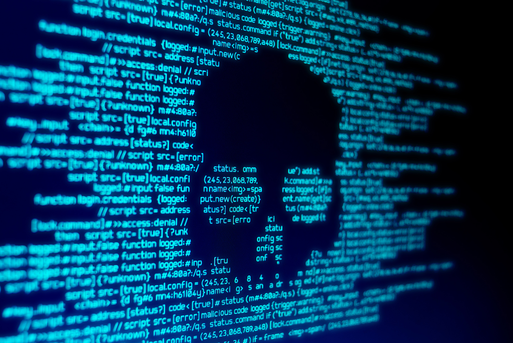 Blue computer code on a screen screen with a skull in black representing a malware attack.